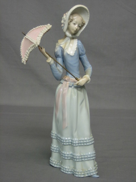 A Lladro Figure Of A Standing Lady With Parasol 13 2nd September