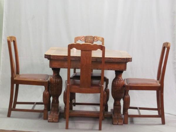 oak dining room suites   A 1930's carved honey oak dining room suite comprising ...